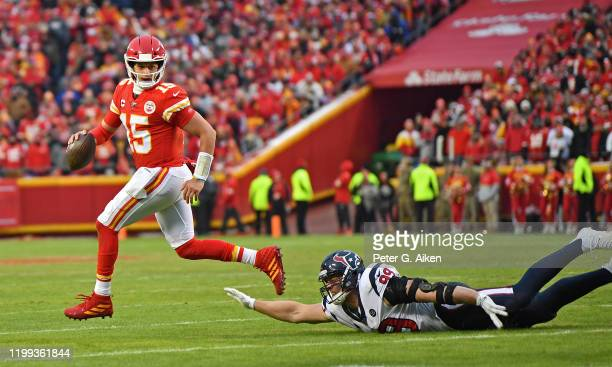 Quarterback Patrick Mahomes of the Kansas City Chiefs rolls out in the first half during the AFC Divisional playoff game against defensive end JJ...