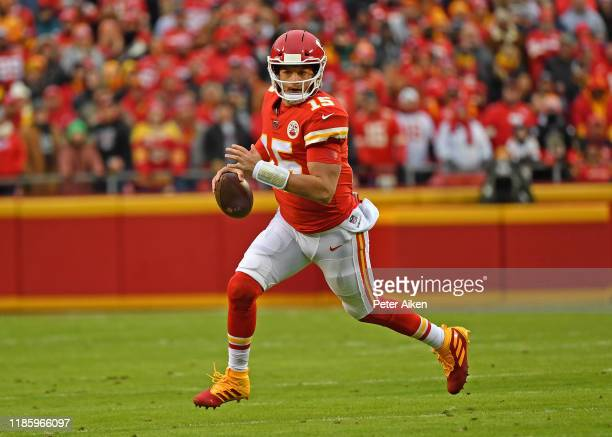 Quarterback Patrick Mahomes of the Kansas City Chiefs rolls out against the Oakland Raiders during the first half at Arrowhead Stadium on December 1...