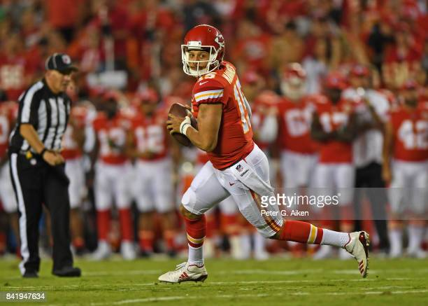 Quarterback Patrick Mahomes of the Kansas City Chiefs rolls out against the Tennessee Titans during the first half of a preseason game on August 31...