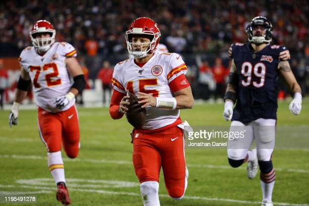 Quarterback Patrick Mahomes of the Kansas City Chiefs runs in a touchdown against outside linebacker Aaron Lynch of the Chicago Bears in the first...
