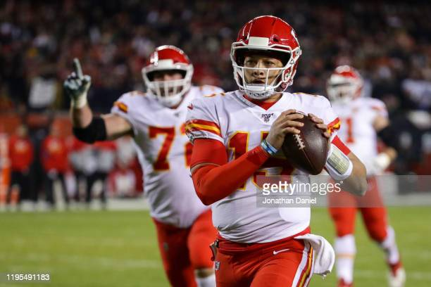Quarterback Patrick Mahomes of the Kansas City Chiefs runs in a touchdown against the Chicago Bears in the first quarter of the game at Soldier Field...