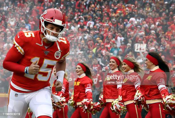 Quarterback Patrick Mahomes of the Kansas City Chiefs runs out of the tunnel as he is introduced prior to the game against the Los Angeles Chargers...