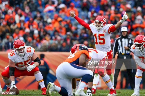 Quarterback Patrick Mahomes of the Kansas City Chiefs runs the offense as offensive tackle Jordan Devey sets to snap the ball against the Denver...