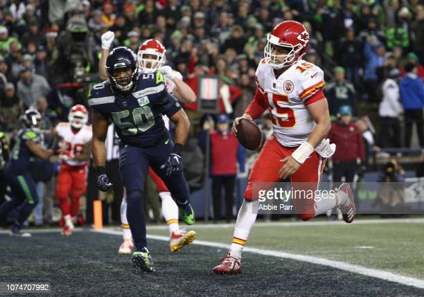 Quarterback Patrick Mahomes of the Kansas City Chiefs rushes up the middle for a two point conversion during the fourth quarter of the game against...