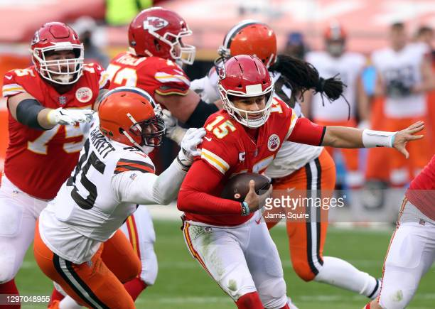 Quarterback Patrick Mahomes of the Kansas City Chiefs scrambles as defensive end Myles Garrett of the Cleveland Browns chases during the AFC...