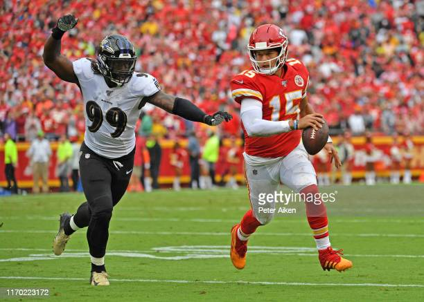 Quarterback Patrick Mahomes of the Kansas City Chiefs scrambles away from outside linebacker Matt Judon of the Baltimore Ravens against during the...