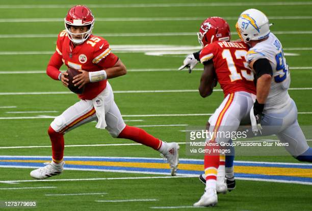 Quarterback Patrick Mahomes of the Kansas City Chiefs scrambles against the Los Angeles Chargers in the second half of a NFL football game at SoFi...