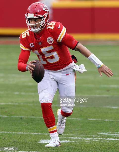 Quarterback Patrick Mahomes of the Kansas City Chiefs scrambles during the AFC Divisional Playoff game against the Cleveland Browns at Arrowhead...