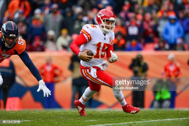 Quarterback Patrick Mahomes of the Kansas City Chiefs scrambles against the Denver Broncos at Sports Authority Field at Mile High on December 31 2017...
