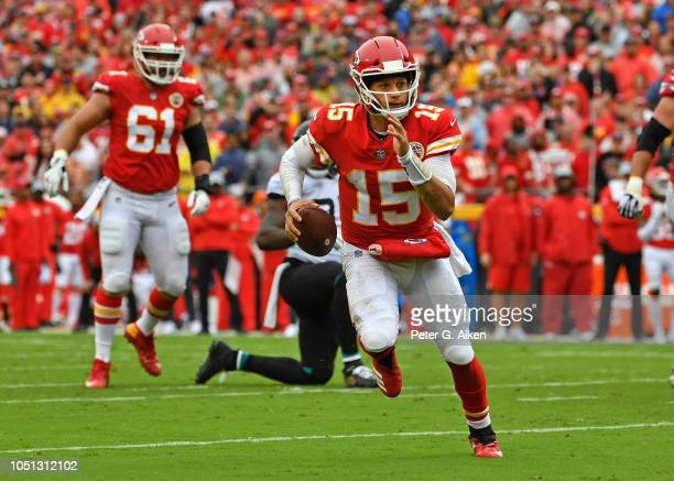 Quarterback Patrick Mahomes of the Kansas City Chiefs scrambles with the ball during the first half against the Jacksonville Jaguars on October 7,...