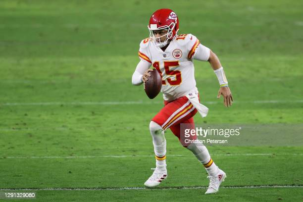 Quarterback Patrick Mahomes of the Kansas City Chiefs scrambles with the football during the NFL game against the Las Vegas Raiders at Allegiant...