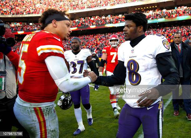 Quarterback Patrick Mahomes of the Kansas City Chiefs shakes hands with quarterback Lamar Jackson of the Baltimore Ravens after the Chiefs defeated...