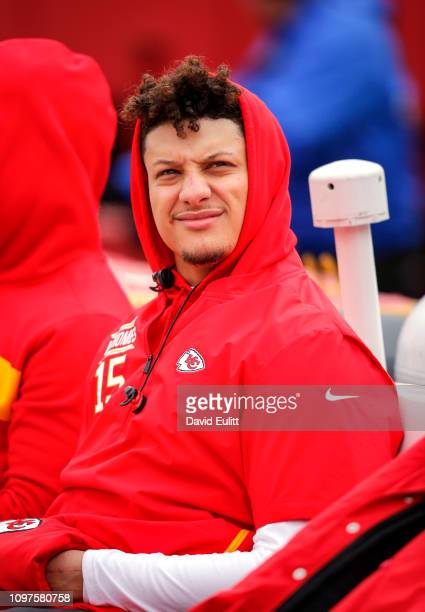 Quarterback Patrick Mahomes of the Kansas City Chiefs sits on the bench during pregame warmups prior to the AFC Championship Game against the New...