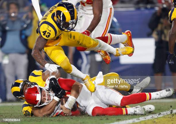 Quarterback Patrick Mahomes of the Kansas City Chiefs slides into the one yard line and doesn't score as John Johnson of the Los Angeles Rams leaps...