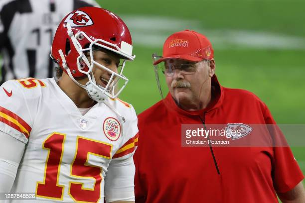 Quarterback Patrick Mahomes of the Kansas City Chiefs talks with head coach Andy Reid before the NFL game against the Las Vegas Raiders at Allegiant...