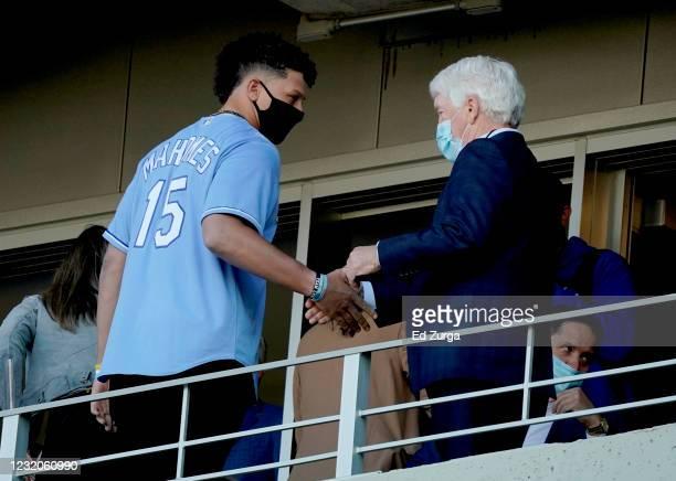 Quarterback Patrick Mahomes of the Kansas City Chiefs talks with Kansas City Royals owner John Sherman during a game between the Texas Rangers and...