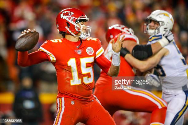 Quarterback Patrick Mahomes of the Kansas City Chiefs threw a third quarter pass with pressure from defensive end Joey Bosa of the Los Angeles...
