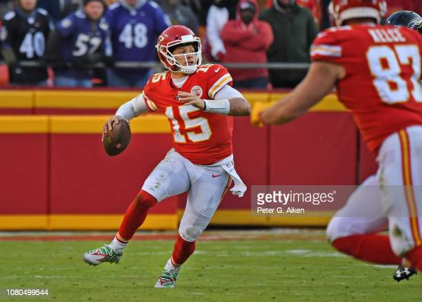 Quarterback Patrick Mahomes of the Kansas City Chiefs throws a pass down field against the Baltimore Ravens late in the second half on December 9...