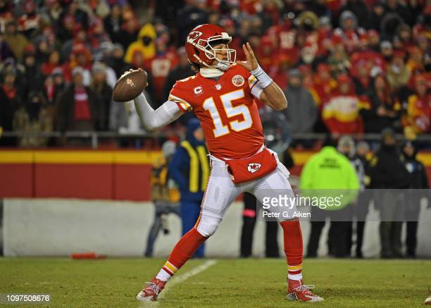 Quarterback Patrick Mahomes of the Kansas City Chiefs throws a pass down field during the first half of the AFC Championship Game against the New...