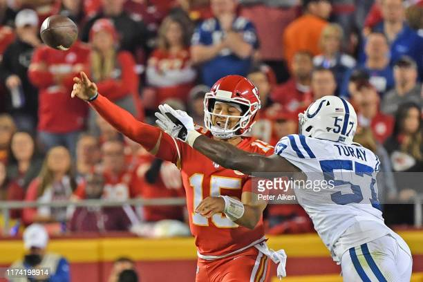 Quarterback Patrick Mahomes of the Kansas City Chiefs throws a pass under pressure from defensive end Kemoko Turay of the Indianapolis Colts against...