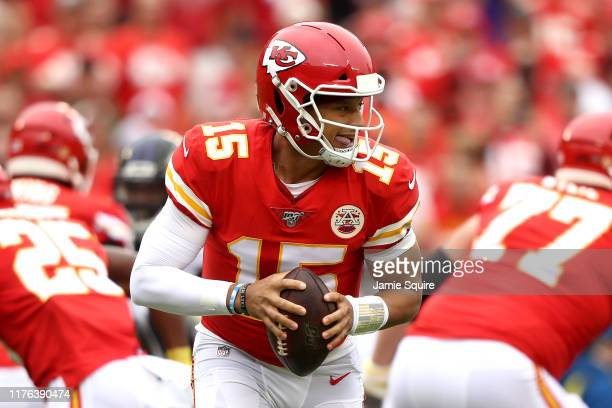 Quarterback Patrick Mahomes of the Kansas City Chiefs throws a pass against the Baltimore Ravens in the first quarter during the game at Arrowhead...