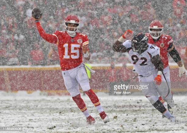 Quarterback Patrick Mahomes of the Kansas City Chiefs throws a pass against defensive end Jonathan Harris of the Denver Broncos during the second...