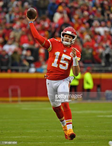 Quarterback Patrick Mahomes of the Kansas City Chiefs throws a pass down field against the Oakland Raiders during the first half at Arrowhead Stadium...