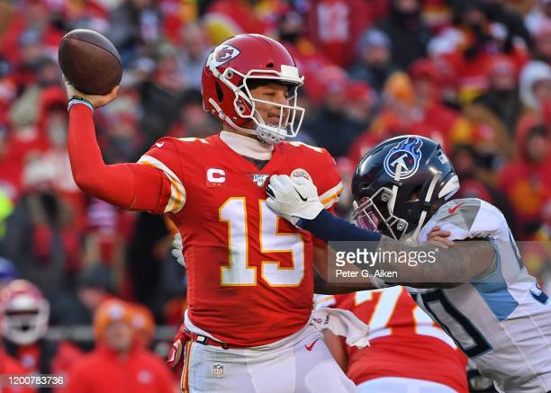 Quarterback Patrick Mahomes of the Kansas City Chiefs throws a pass down field in the second half against pressure from linebacker Derick Roberson of...
