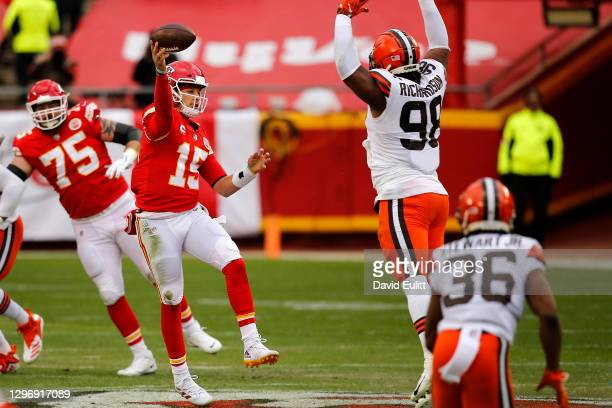 Quarterback Patrick Mahomes of the Kansas City Chiefs throws a pass over the defensive tackle Sheldon Richardson of the Cleveland Browns during the...