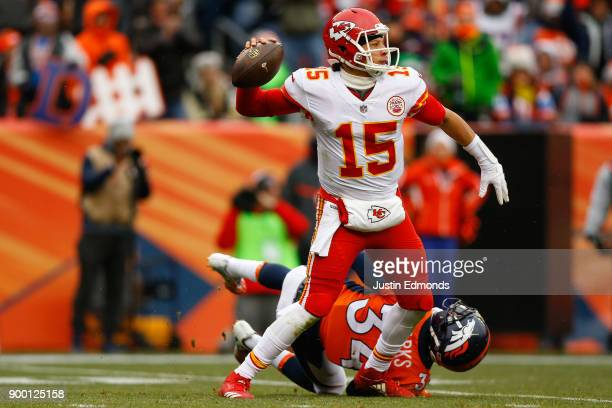 Quarterback Patrick Mahomes of the Kansas City Chiefs throws a pass for a first down after eluding defensive back Will Parks of the Denver Broncos...