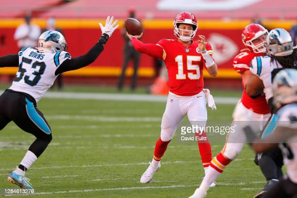 Quarterback Patrick Mahomes of the Kansas City Chiefs throws his 100th touchdown pass against the Carolina Panthers in the fourth quarter at...