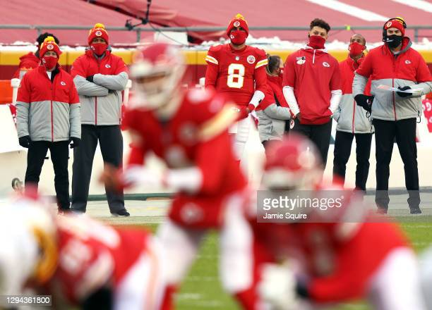 Quarterback Patrick Mahomes of the Kansas City Chiefs watches from the sidelines alongside quarterback Matt Moore during the game against the Los...
