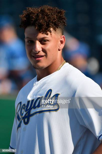 Quarterback Patrick Mahomes of the Kansas City Chiefs watches the Kansas City Royals take batting practice prior to a game against the New York...