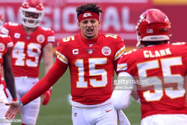Quarterback Patrick Mahomes of the Kansas City Chiefs welcomes defensive end Frank Clark onto the field to start the AFC Divisional Playoff game...