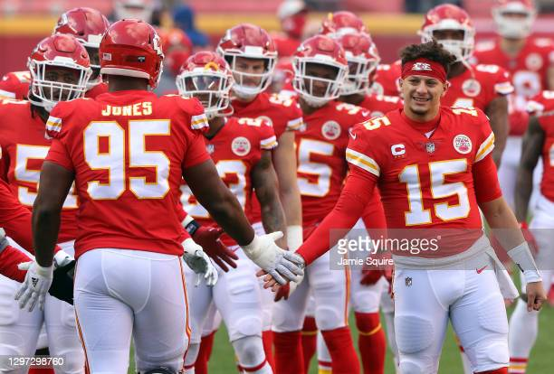 Quarterback Patrick Mahomes of the Kansas City Chiefs welcomes defensive tackle Chris Jones onto the field to start the AFC Divisional Playoff game...