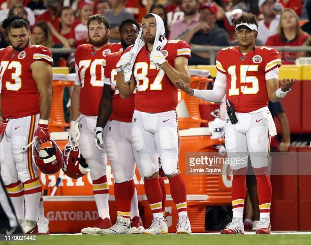 Quarterback Patrick Mahomes tight end Travis Kelce offensive tackle Pace Murphy and offensive guard Nick Allegretti of the Kansas City Chiefs watch...