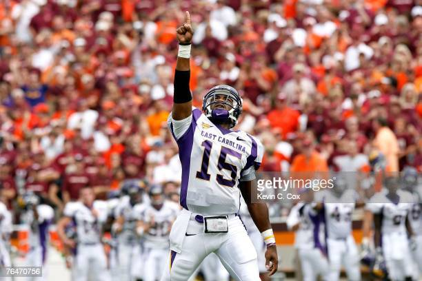 Quarterback Patrick Pinkney of the East Carolina Pirates reacts after the Pirates scored a touchdown against the Virginia Tech Hokies on September 1...