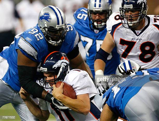 Quarterback Patrick Ramsey of the Denver Broncos collides with defensive tackle Shaun Rogers of the Detroit Lions during the second half at Ford...