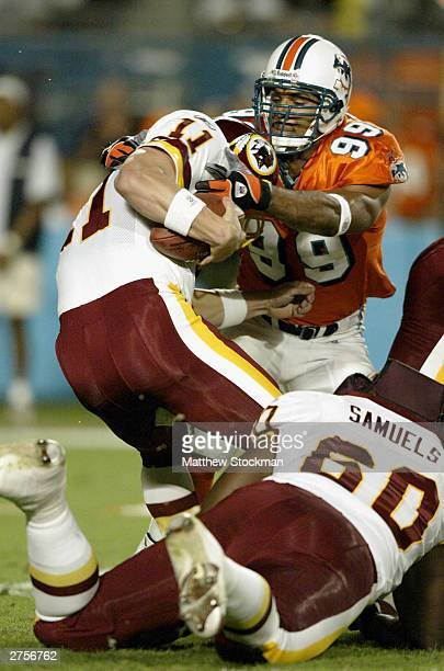 Quarterback Patrick Ramsey of the Washington Redskins is sacked by Jason Taylor of the Miami Dolphins November 23 2003 at Pro Player Stadium in Miami...