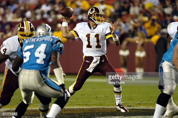 Quarterback Patrick Ramsey of the Washington Redskins throws a pass against the Carolina Panthers on August 14 2004 at Fed Ex Field in Landover...