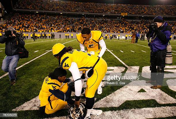 Quarterback Patrick White and Markell Harrison console Larry Williams of the West Virginia Mountaineers after their loss to the Pittsburgh Panthers...