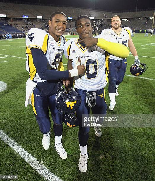 Quarterback Patrick White and running back Steve Slaton of the West Virginia University Mountaineers celebrate after defeating the University of...