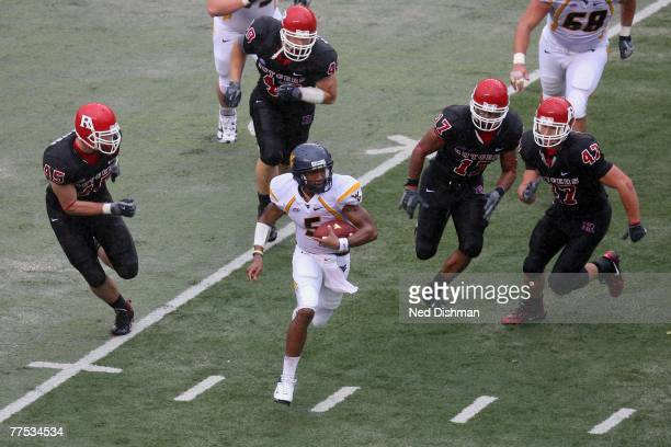 Quarterback Patrick White of the West Virginia Mountaineers runs against the Rutgers University Scarlet Knights on October 27 2007 at Rutgers Stadium...