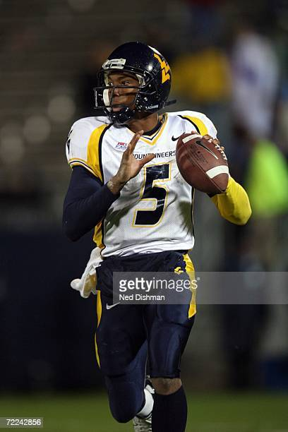 Quarterback Patrick White of the West Virginia University Mountaineers looks to pass against the University of Connecticut Huskies at Rentschler...