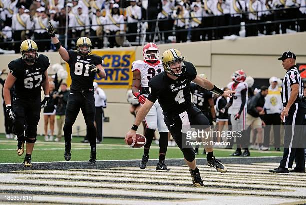 Quarterback Patton Robinette of the Vanderbilt Commodores scores a touchdown against the Georgia Bulldogs at Vanderbilt Stadium on October 19 2013 in...