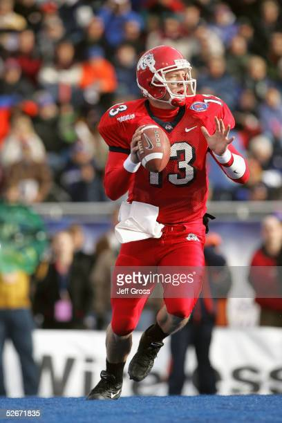 Quarterback Paul Pinegar of the Fresno State Bulldogs drops back to pass against the Virginia Cavaliers during the MPC Computers Bowl at Bronco...