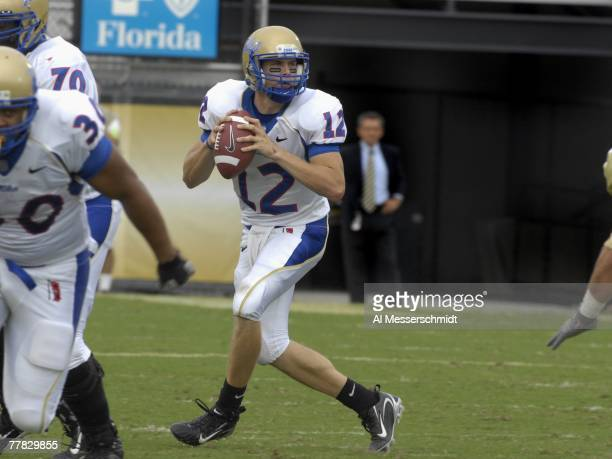 Quarterback Paul Smith of the Tulsa Golden Hurricane sets to pass against the University of Central Florida Knights at Bright House Stadium on...