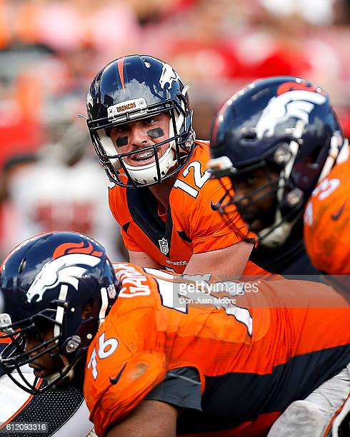 Quarterback Paxton Lynch of the Denver Broncos calls signals at the line of scrimmage during the game against the Tampa Bay Buccaneers at Raymond...