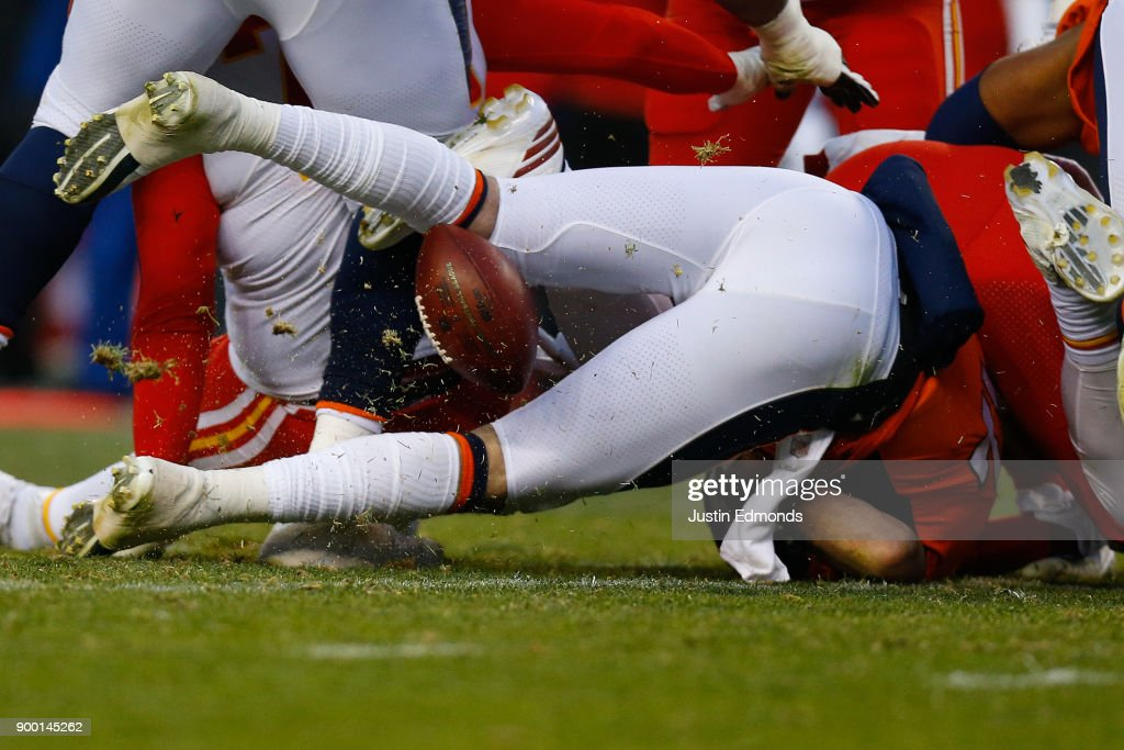 Quarterback Paxton Lynch #12 of the Denver Broncos fumbles the football during the third quarter against the Kansas City Chiefs at Sports Authority Field at Mile High on December 31, 2017 in Denver, Colorado. The Chiefs defeated the Broncos 27-24.