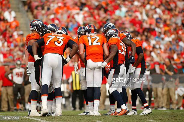 Quarterback Paxton Lynch of the Denver Broncos huddles the offense during the third quarter of an NFL game against the Tampa Bay Buccaneers on...